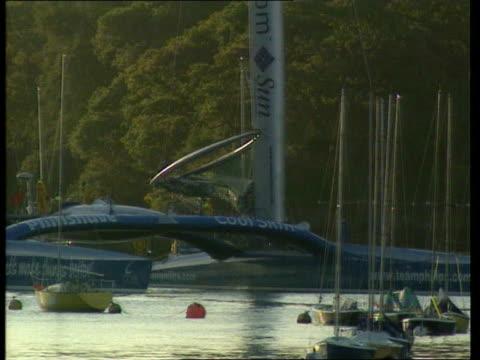 team philips catamaran arrives in port england devon dartmouth ext general views of team philips catamaran approaching port / catamaran along / crew... - dartmouth england stock videos & royalty-free footage