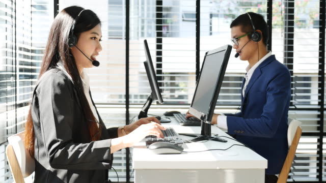 team telephone operator talking at office, call center - headset stock videos & royalty-free footage