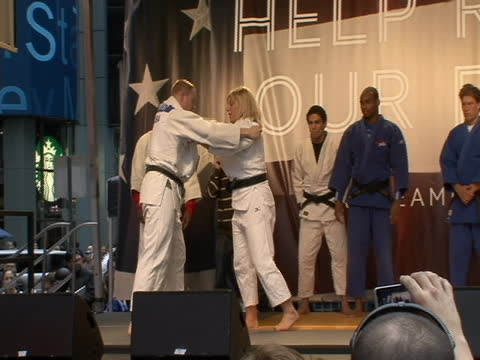 team usa tae kwon do demonstration on stage at countdown to olympics event in times square in new york city. athletes demos, - sport stock videos & royalty-free footage