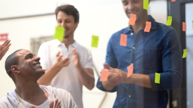 team working from sticky notes - efficiency stock videos & royalty-free footage