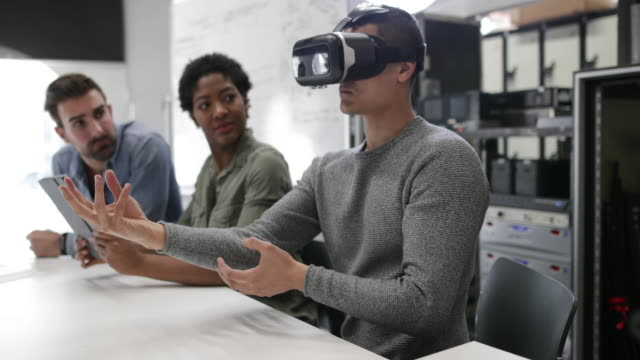 team working on virtual reality headset - cyberspace stock videos & royalty-free footage