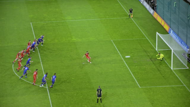 Teammates celebrating goalkeeper's save from the penalty kick