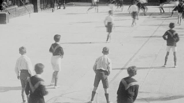 1925 MONTAGE Teams of schoolboys playing skittle-ball, rugby, and football on courts and ball fields / Newcastle upon Tyne, England, United Kingdom