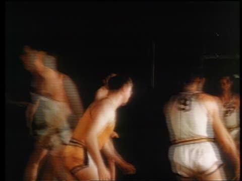 stockvideo's en b-roll-footage met 1945 pan 2 teams playing basketball / one man makes basket / industrial - wyoming