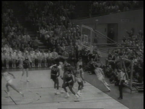 teams playing / crowd watching / crowd milling on floor / players lifting up ucla player / ucla team posing for picture - 1965 stock videos & royalty-free footage