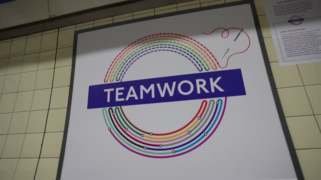 """teamwork"""" by joseph, planning manager at brixton london underground station at tfl installs new equality signs across london underground tube network... - business finance and industry stock videos & royalty-free footage"""