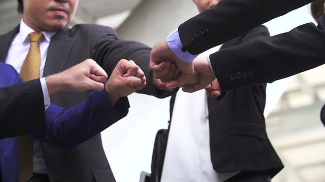 teamwork concepts. business people joining hands.slow motion shooting. - harmony stock videos & royalty-free footage