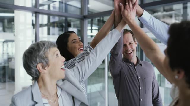 teamwork creates winners, winners work together - aspirations stock videos & royalty-free footage
