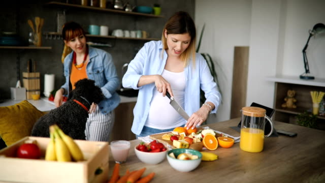 teamwork in kitchen - pregnant stock videos & royalty-free footage