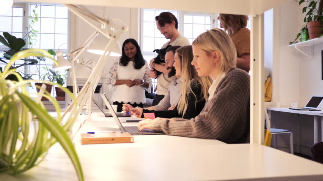 teamwork in modern coworking space - multi ethnic group of professionals working together - sweden stock videos & royalty-free footage