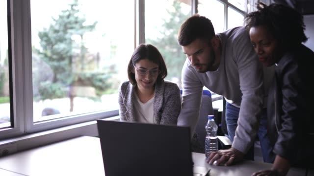 Teamwork in modern office place