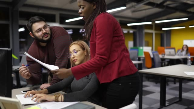 teamwork is always good idea - colleague help stock videos & royalty-free footage