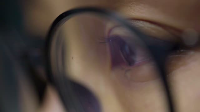 CLOSE UP: Tear comes out of an eye and streaks down the cheek. Sad abused female with brown eyes crying , Asian Model.