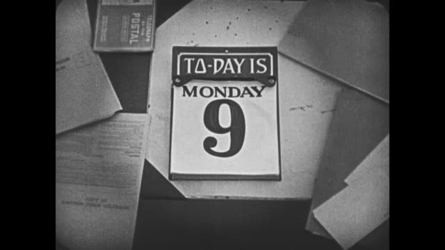1920 A tear off calendar on a cluttered desk reads 'Today is Monday 9'