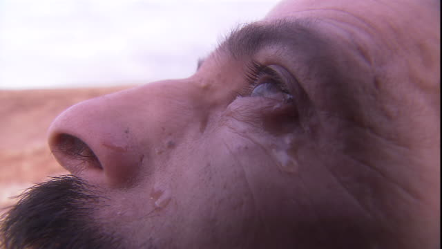a tear rolls down a man's cheek as he looks skyward. - north africa stock videos & royalty-free footage