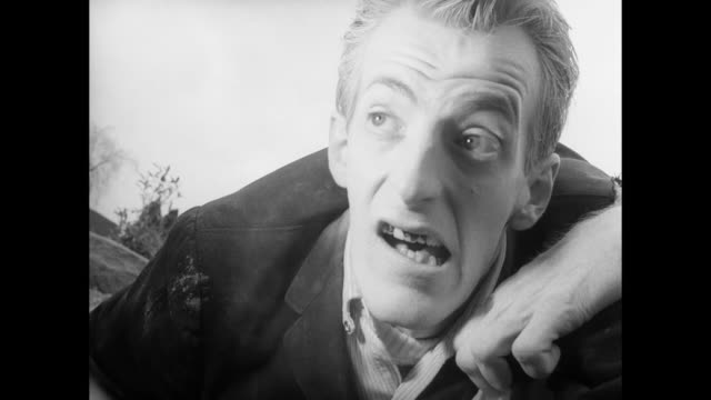 1968 teasing man fights with zombie after he mocks fearful and hiding woman - zombie stock videos & royalty-free footage