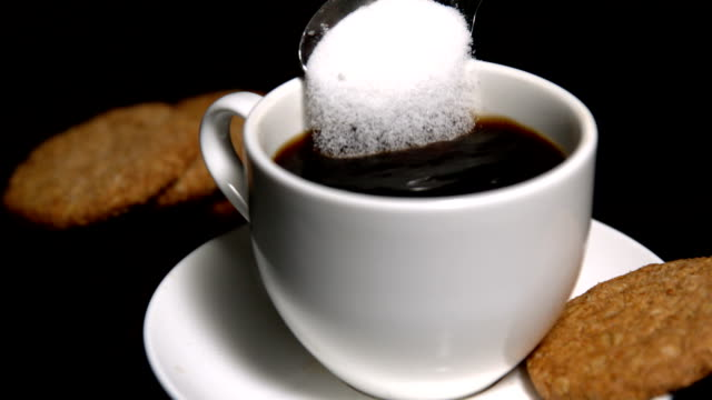 teaspoon pouring sugar into cup of coffee - teaspoon stock videos and b-roll footage