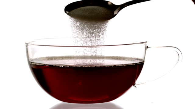 teaspoon pouring sugar into cup of tea - teaspoon stock videos and b-roll footage