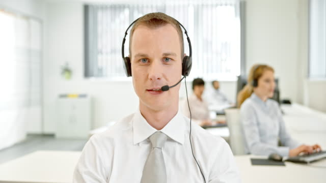 LD Technical support male operator on video call with customer