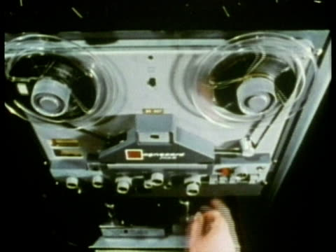 1969 CU HA Technician adjusting reel-to-reel tape recorder playing in sound booth during hearing test/ USA/ AUDIO
