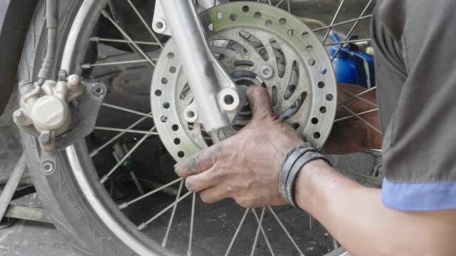 technician assembly wheel motorcycle - tire vehicle part stock videos and b-roll footage