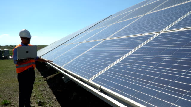 technician at solar panel station - carbon footprint stock videos and b-roll footage