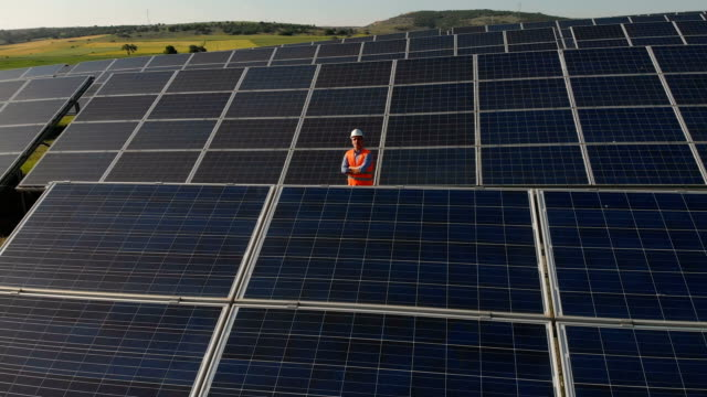 technician at solar power station aerial shot - technician stock videos & royalty-free footage