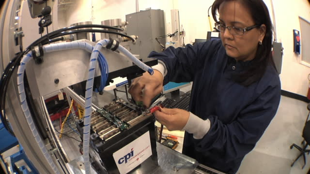 ms technician attaching wire to negative terminal while testing prototype lithium ion battery used to power electric automobile / troy, michigan, usa - lithium ion battery stock videos & royalty-free footage