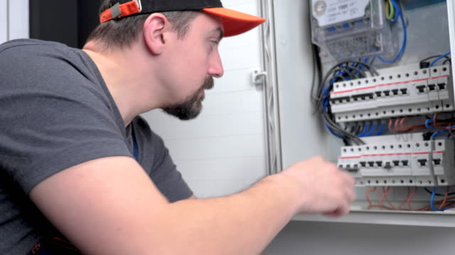 technician checking fuse box - meter instrument of measurement stock videos & royalty-free footage