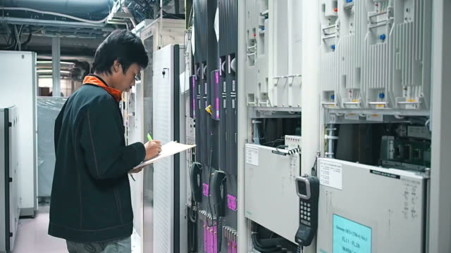 Technician checking network in office