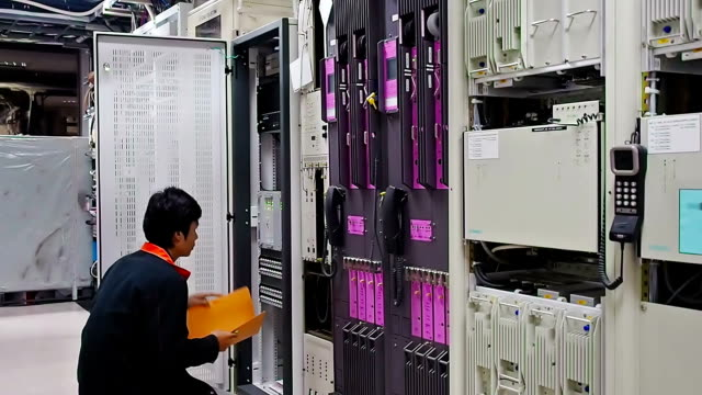 Technician checking network system