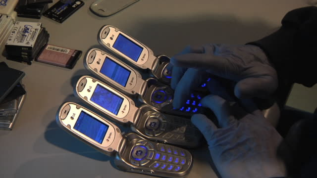 cu zo technician conducting call testing on refurbished cell phones / dexter, michigan, usa - repairing stock videos & royalty-free footage