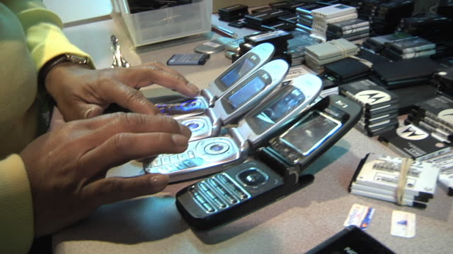 cu technician conducting call testing on refurbished cell phones / dexter, michigan, usa - one mature woman only stock-videos und b-roll-filmmaterial
