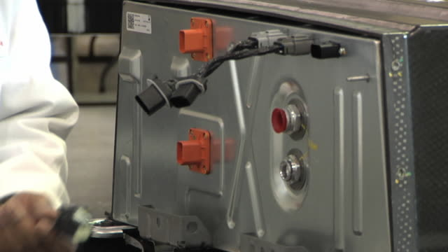 cu zo technician connecting wires  to test prototype lithium ion battery used to power electric automobile / troy, michigan, usa - lithium ion battery stock videos & royalty-free footage