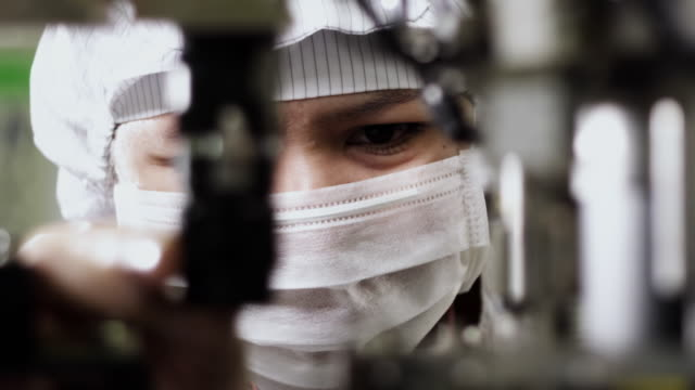 CU TD R/F Technician examining semiconductor of manufacturing machinery / Bang Pa-In, Ayutthaya, Thailand