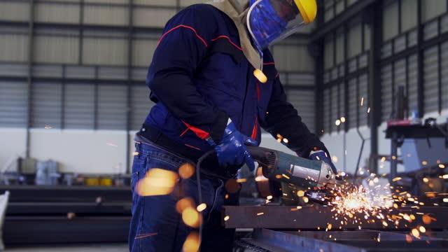 technician grinding metal in the workshop. - work tool stock videos & royalty-free footage