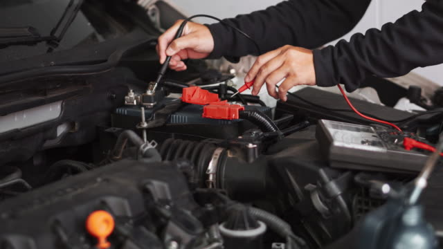 technician hands of car mechanic working in auto repair service and maintenance car battery - motor video stock e b–roll