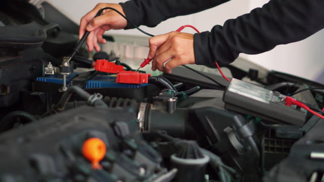 technician hands of car mechanic working in auto repair service and maintenance car battery - repairing stock videos & royalty-free footage