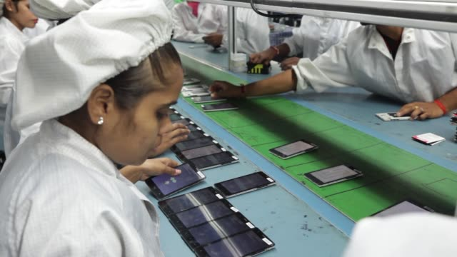 technician inspects the menu function on a row of smartphones on the production line inside the intex technologies india ltd. plant in noida, uttar... - electronics industry stock videos & royalty-free footage