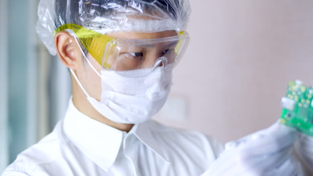 Technician man in the Clean room