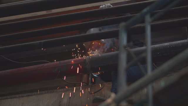 technician metal cutting with welding gas, grinding of metal sparks falling on the floor in metal cutting process, work hard dismantling the metal construction at height in the factory - danger stock videos & royalty-free footage
