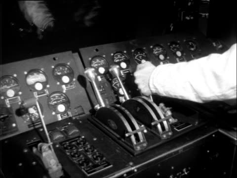 technician opens throttle lever to test output levels on unseen jet engine needle on gauge rises; 1950s - throttle stock videos & royalty-free footage