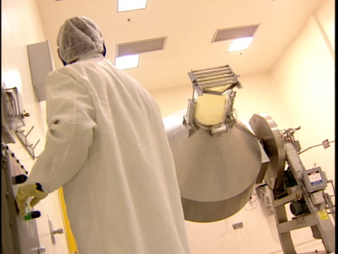 ms technician operating spinning mixer in laboratory / new jersey, usa - クリーンスーツ点の映像素材/bロール