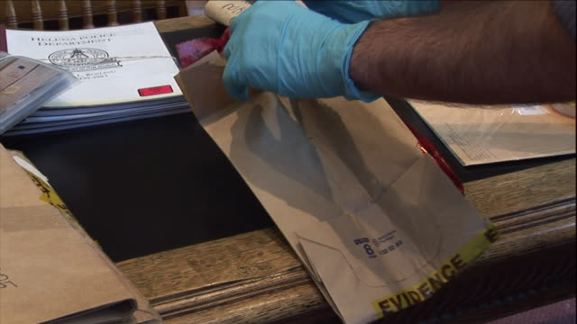 a technician places a knife into an evidence bag. - pamphlet stock videos & royalty-free footage