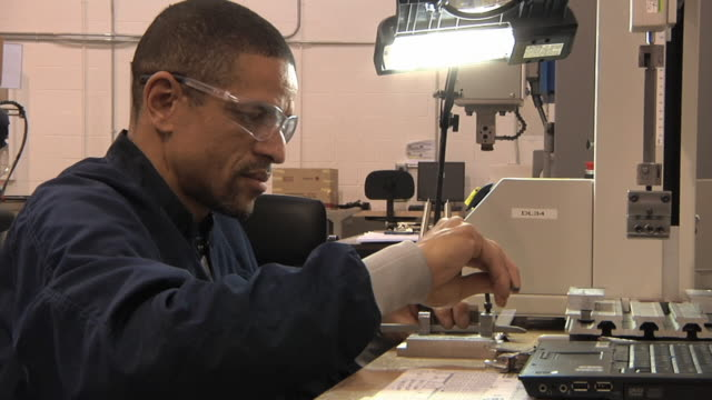 cu technician preparing to test prototype lithium ion battery used to power electric automobile / troy, michigan, usa - lithium ion battery stock videos & royalty-free footage