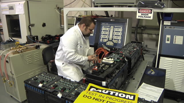 MS Technician preparing to test prototype lithium ion battery used to power electric automobile / Troy, Michigan, USA