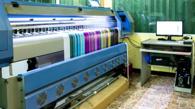 technician printing vinyl multi color cmyk on inkjet printer - printer occupation stock videos and b-roll footage