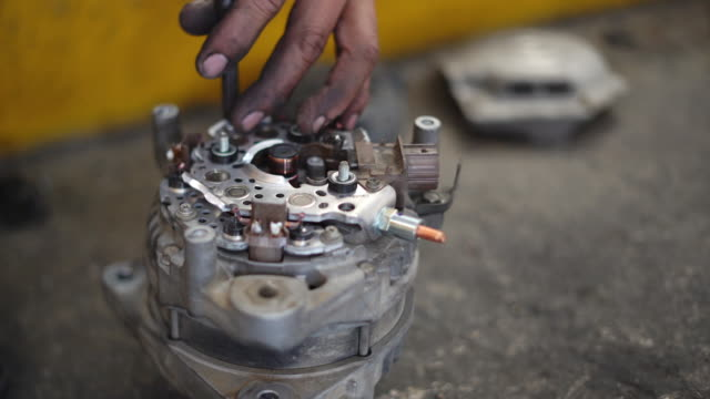 technician repairing an alternator at the garage - part of vehicle stock videos & royalty-free footage