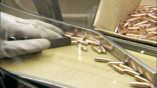 a technician sorts newly forged bullets. - weaponry stock videos & royalty-free footage