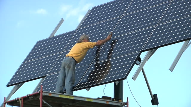 WS ZI PAN Technician testing photovoltaic array / Grass Lake, Michigan, USA